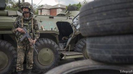 Силы АТО уничтожили укрепления боевиков и взял под контроль мост через реку