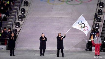 В Пекине торжественно встретили олимпийский флаг, доставленный из Пхенчхана