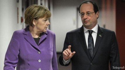 Меркель и Олланд призвали Путина прекратить бои в Украине