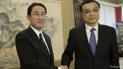 Японский глава МИД поехал в Пекин