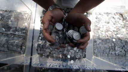 Территории Британии смогут чеканить фунтовую монету с собственным дизайном