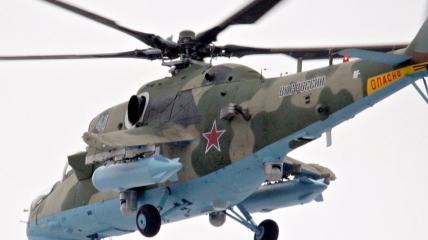 Военный вертолет РФ обстреляли их охотничьих ружей
